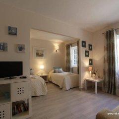 Отель Old Village Apartamentos Ov International удобства в номере