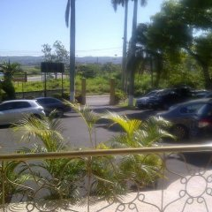 Отель Palm Bay Guest House & Restaurant Ямайка, Монтего-Бей - отзывы, цены и фото номеров - забронировать отель Palm Bay Guest House & Restaurant онлайн парковка