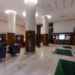 Гостиница Holiday Inn Aktau Казахстан, Актау - отзывы, цены и фото номеров - забронировать гостиницу Holiday Inn Aktau онлайн интерьер отеля