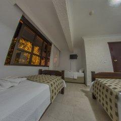 Ados Hotel Чешме комната для гостей фото 3