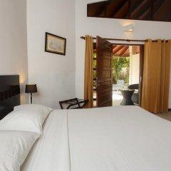 Отель Embudu Village Мальдивы, Велиганду Хураа - отзывы, цены и фото номеров - забронировать отель Embudu Village онлайн комната для гостей