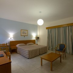 Kefalos - Damon Hotel Apartments Пафос комната для гостей фото 2