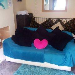 Апартаменты Sakina Apartment Эдинбург комната для гостей фото 4