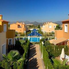 Отель Apartamentos Y Villas Oliva Nova Golf Олива балкон