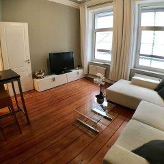 Апартаменты Bluecity Apartments Гамбург комната для гостей