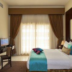 Arabian Dreams Deluxe Hotel Apartments комната для гостей
