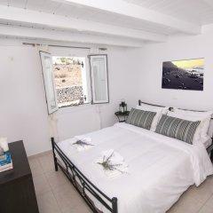 Отель Apanomeria Boutique Resident Греция, Остров Санторини - отзывы, цены и фото номеров - забронировать отель Apanomeria Boutique Resident онлайн комната для гостей