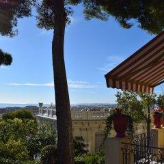 Отель Hôtel Le Petit Palais Франция, Ницца - отзывы, цены и фото номеров - забронировать отель Hôtel Le Petit Palais онлайн балкон