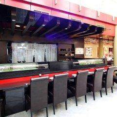 Отель AMOY by Far East Hospitality гостиничный бар
