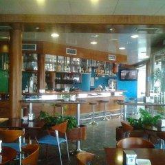 Отель Astuy Apartamentos Арнуэро гостиничный бар