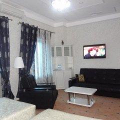 Гостиница Астрал (комплекс А) в Тихвине отзывы, цены и фото номеров - забронировать гостиницу Астрал (комплекс А) онлайн Тихвин комната для гостей фото 2