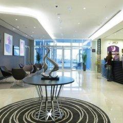 Отель Premier Inn Abu Dhabi Capital Centre фитнесс-зал фото 3