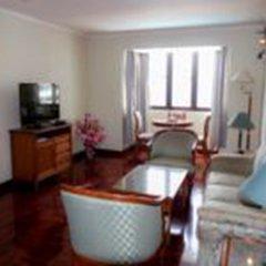 Отель Omni Tower Syncate Suites Бангкок комната для гостей фото 2
