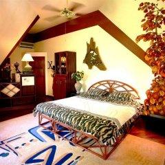 Отель Coco Palace Resort Пхукет комната для гостей