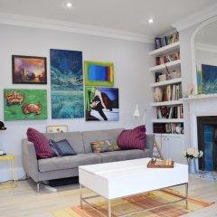 Отель Modern and Spacious Belsize Park Apartment Великобритания, Лондон - отзывы, цены и фото номеров - забронировать отель Modern and Spacious Belsize Park Apartment онлайн развлечения