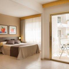 Aqua Hotel Montagut Suites комната для гостей