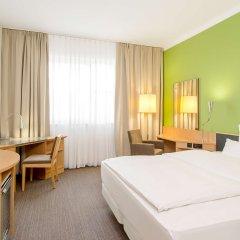 Отель NH München Messe Германия, Мюнхен - 2 отзыва об отеле, цены и фото номеров - забронировать отель NH München Messe онлайн комната для гостей фото 2