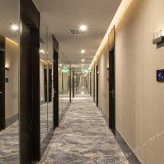 Отель IU Hotel Tianjin Sky Tower Resorts Cathay Китай, Тяньцзинь - отзывы, цены и фото номеров - забронировать отель IU Hotel Tianjin Sky Tower Resorts Cathay онлайн интерьер отеля фото 2