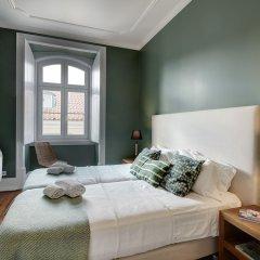 Апартаменты Lisbon Canaan Boutique Apartments Gaivotas комната для гостей фото 3