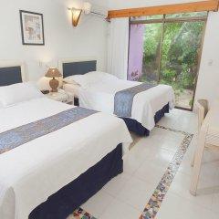 Отель Cocoplum Beach Колумбия, Сан-Луис - 1 отзыв об отеле, цены и фото номеров - забронировать отель Cocoplum Beach онлайн комната для гостей