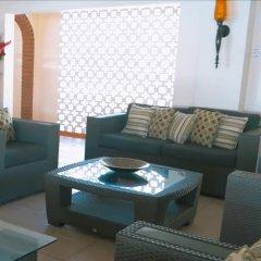 Отель Sunset Shores Beach Hotel Сент-Винсент и Гренадины, Остров Бекия - отзывы, цены и фото номеров - забронировать отель Sunset Shores Beach Hotel онлайн интерьер отеля фото 3