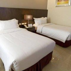 Mandarin Plaza Hotel комната для гостей фото 3