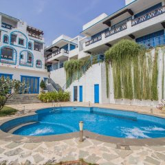 Отель OYO 11899 Home Greek Style 4BHK Penthouse Bambolim Гоа бассейн