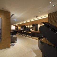 Отель First Cabin Atagoyama Япония, Токио - отзывы, цены и фото номеров - забронировать отель First Cabin Atagoyama онлайн интерьер отеля фото 2
