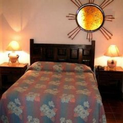 Отель Suites La Siesta Пуэрто-Вальярта в номере