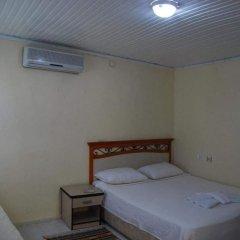 Отель Arya Holiday Houses сейф в номере