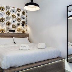 Апартаменты The Athenians Modern Apartments комната для гостей