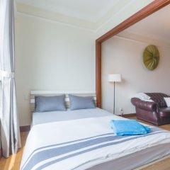 Апартаменты The Manor Luxury 1BR Apartment Center комната для гостей фото 4