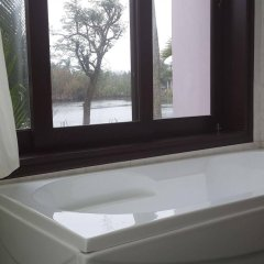 Отель Riverside Garden Villas ванная фото 2