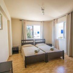 Отель Konnos 2 Bedroom Apartment Кипр, Протарас - отзывы, цены и фото номеров - забронировать отель Konnos 2 Bedroom Apartment онлайн комната для гостей фото 5