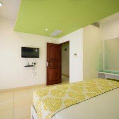 Отель Thilhara Days Inn Шри-Ланка, Коломбо - отзывы, цены и фото номеров - забронировать отель Thilhara Days Inn онлайн удобства в номере фото 2