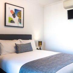 Апартаменты Baxter Street Apartments комната для гостей