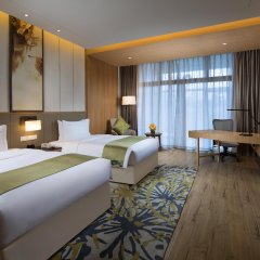 Отель Holiday Inn Kunshan Huaqiao комната для гостей