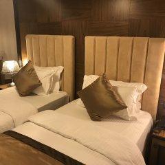 Отель Colosseo Tirana Албания, Тирана - 1 отзыв об отеле, цены и фото номеров - забронировать отель Colosseo Tirana онлайн комната для гостей