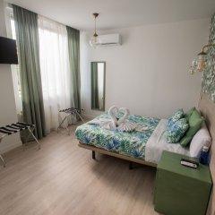 Отель Escala Suites удобства в номере