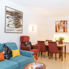Апартаменты Oura View Beach Club Apartments комната для гостей фото 4