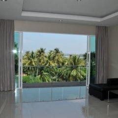 Отель AM Surin Place комната для гостей фото 15