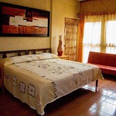 Отель Villas Las Azucenas Мексика, Сиуатанехо - отзывы, цены и фото номеров - забронировать отель Villas Las Azucenas онлайн комната для гостей фото 4