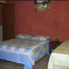 Отель Guesthouse Dos Molinos Сан-Педро-Сула комната для гостей