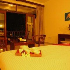 Отель Whispering Palms Hotel Шри-Ланка, Бентота - отзывы, цены и фото номеров - забронировать отель Whispering Palms Hotel онлайн комната для гостей фото 2