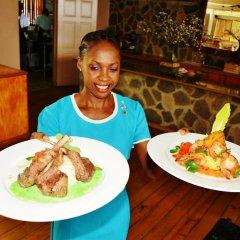 Отель Beachcombers Hotel Сент-Винсент и Гренадины, Остров Бекия - отзывы, цены и фото номеров - забронировать отель Beachcombers Hotel онлайн питание