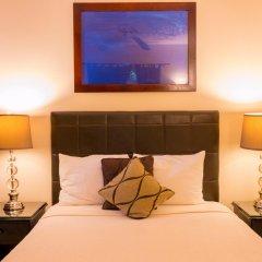 Отель Travellers Beach Resort сейф в номере