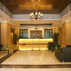 Отель The Star River Apartment Китай, Гуанчжоу - отзывы, цены и фото номеров - забронировать отель The Star River Apartment онлайн интерьер отеля фото 3