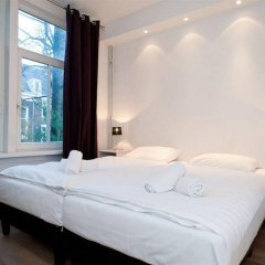 Отель The Leidse Square Stay комната для гостей