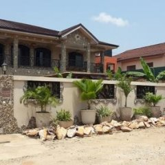 Отель Accra Lodge Тема