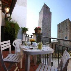 Отель Fabio Apartments Италия, Сан-Джиминьяно - отзывы, цены и фото номеров - забронировать отель Fabio Apartments онлайн балкон